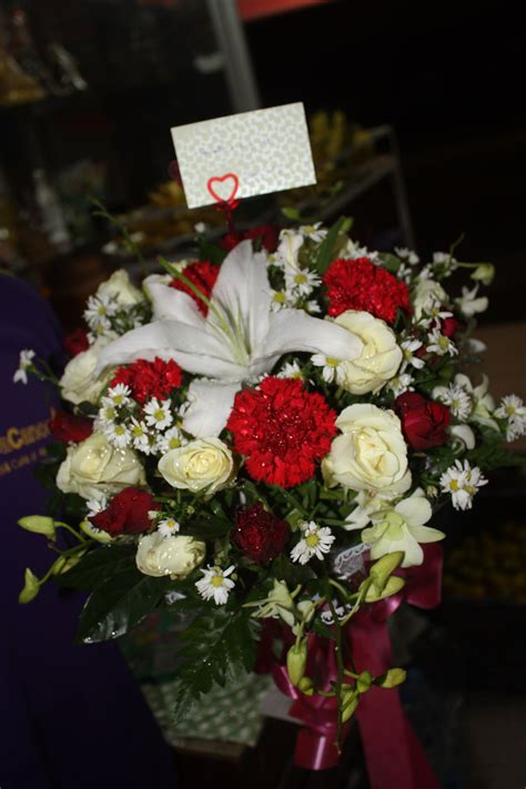 White Roses-White Lily-White Orchids-Red Carnations